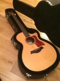 Taylor 712-CE acoustic guitar.
