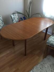 Solid wood extendable dinning table for sale.