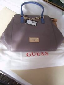 Guess Handbag...new never used unwanted gift with tags with Guess cloth bag.
