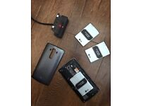 LG G4 mobile phone with 4 batteries, battery charging cradle, gel case and glass screen protector