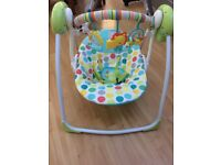 Baby Swing in good condition that rocks automatically