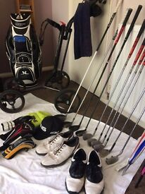 golf clubs . bag and trolly