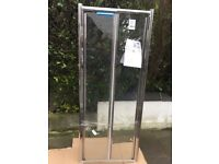 Folding shower door. Brand new