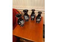 4 matching black vases