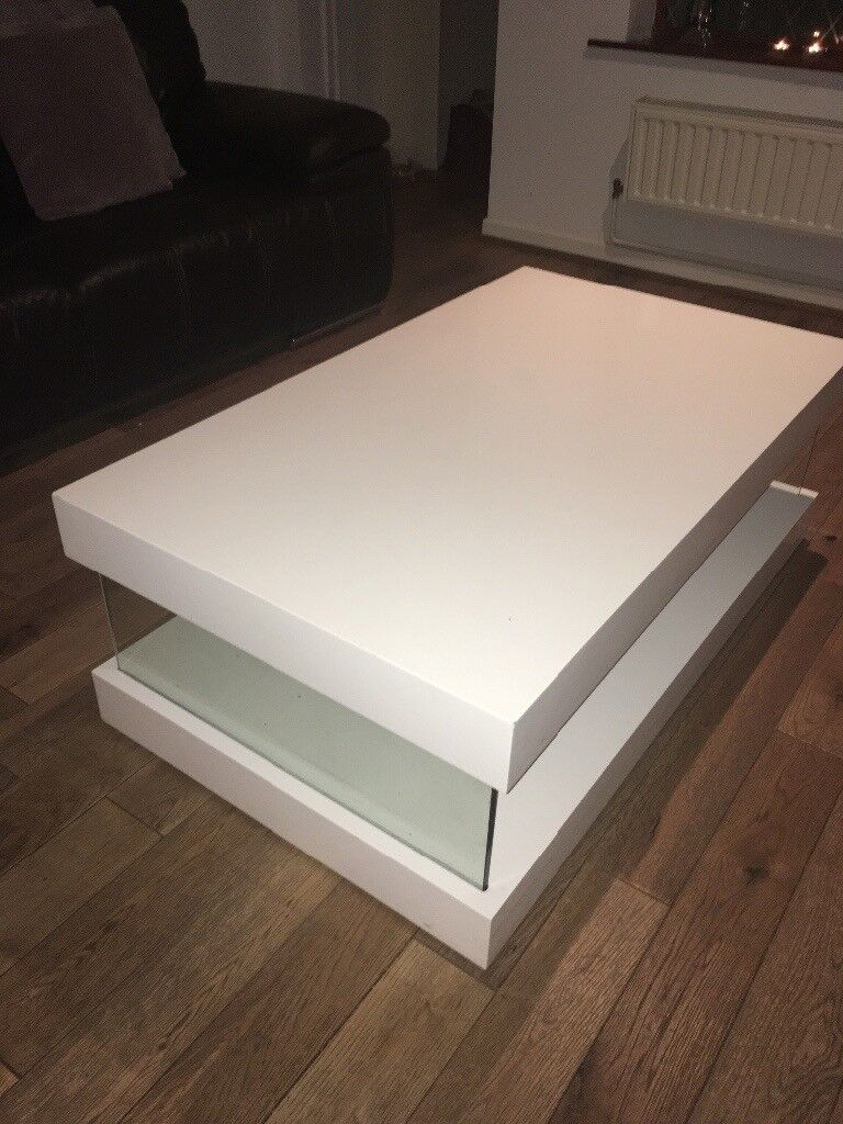 HOUSING UNITS white high gloss coffee table.