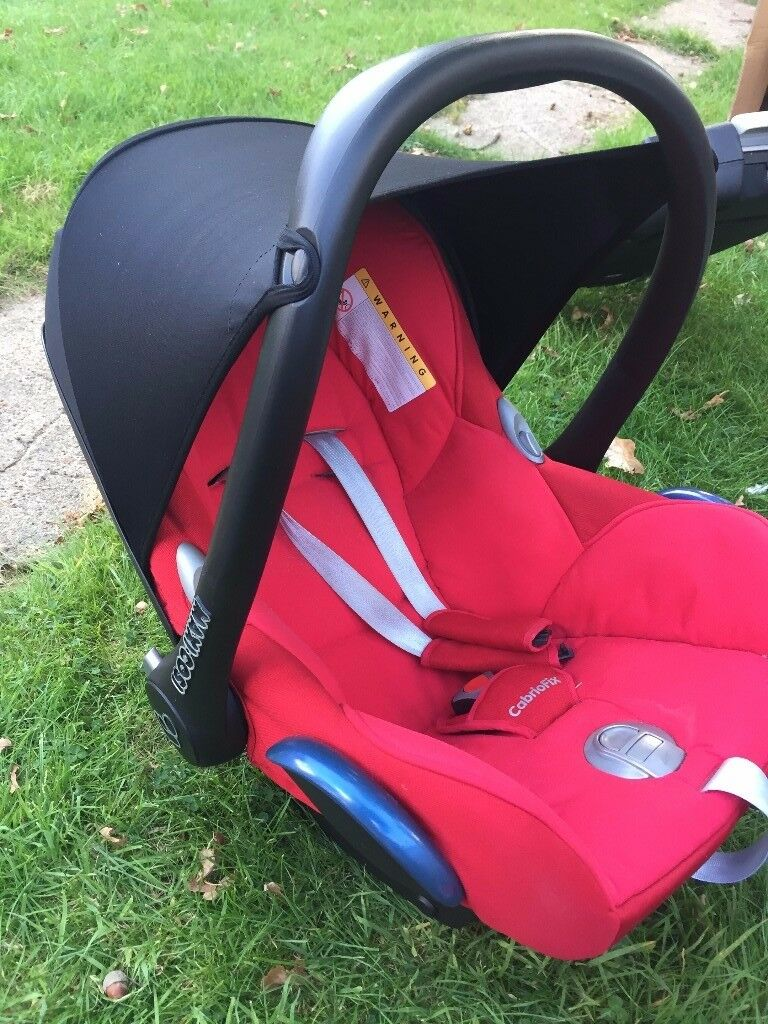 Red maxi cosi Cabriofix car seat / isofix base / adaptors for Bugaboo