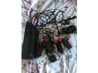 Playstation 2 with buzz and games