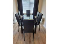 Cucina Extending Dining Table (Black Glass and Metal) with Six Dining Chairs (Black Faux Leather)