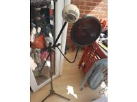 Blue snowball microphone with stand and filter.