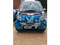 Smart car numeric blue 04 plate