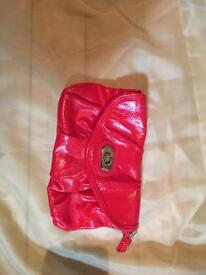 Small red clutch bag