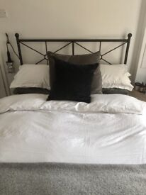 Grey bed frame and mattress