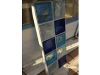 10 dark blue, light blue and clear glass bricks