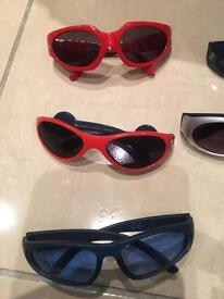 7 Next boys sunglasses ranging from 2 yrs to 8 yrs