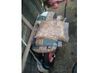 6 bags of Pea gravel and wheelbarrow