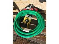 Approximately 14 metres thick heavy duty reinforced hose pipe complete with all fittings & spray gun