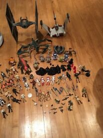 Star Wars toy figures and fighters