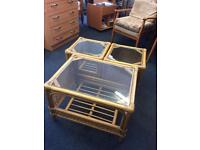 Set of 3 glass topped wicker tables.