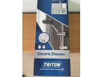 Triton electric shower. Brand new