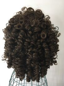 Split curl, medium length wig. Brown. Used for Irish Dancing.