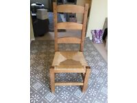4 solid wood dining chairs with wicker seats