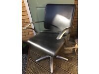 Two hairdressing chairs