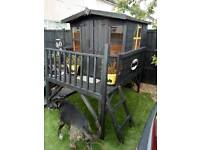 Bespoke Batman playhouse with sandpit and picnic bench