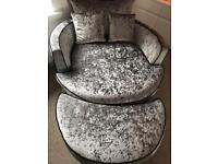 Luxury silver crushed velvet Cuddler swivel chair and matching footstool