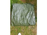 2 tarpaulin and a small bbq cover