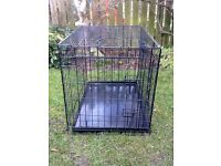 MEDIUM SIZED DOG CAGE IN ALMOST NEW CONDITION FOR SALE. COULD DELIVER.