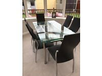 Extendable glass top dining table and chairs