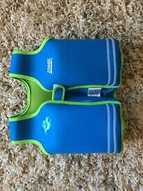 Swim jacket ZOGGS, size 4-5 years, weight 18-25 kg, used once. Also arm bands, y.o.1-6, max 25 kg.