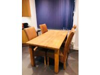 Solid oak table with 4 brown leather chairs