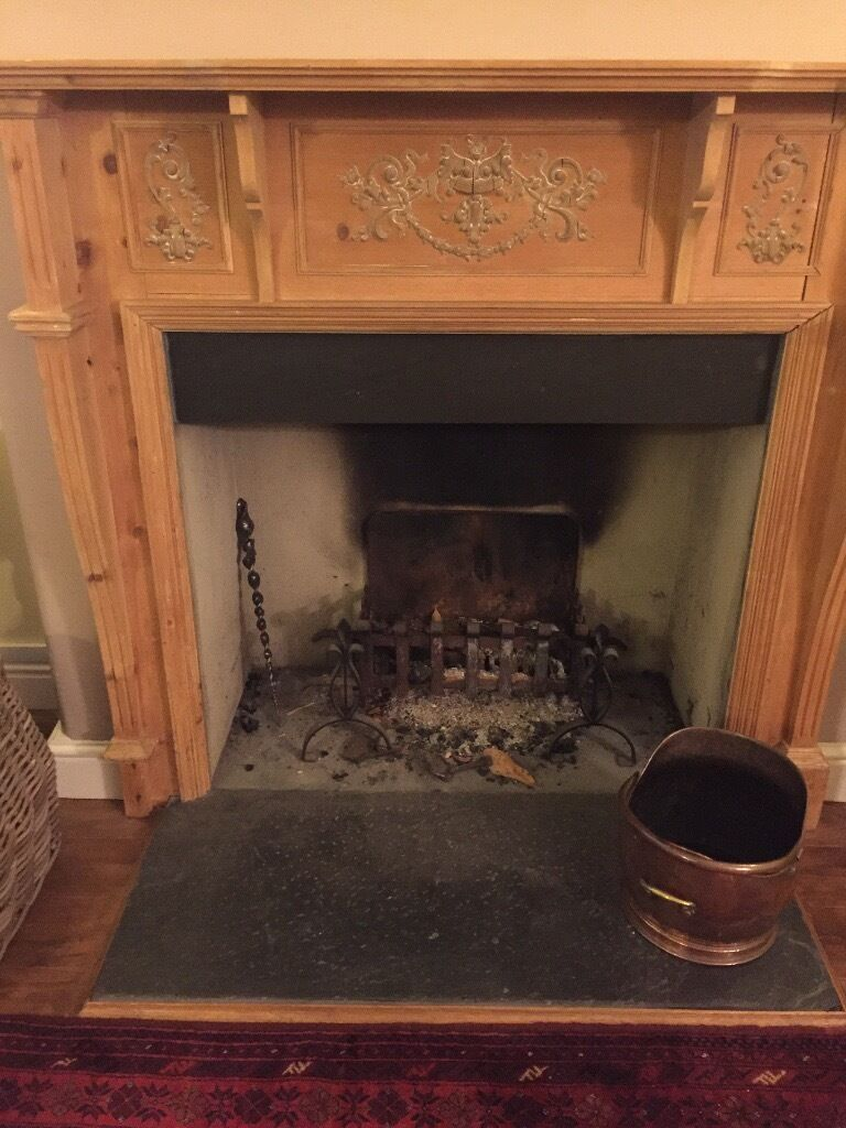 Lovely wooden surround for fire place