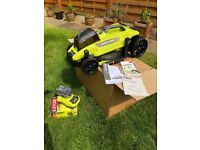 Brand new boxed Ryobi cordless lawnmower with the best battery and charger
