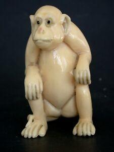 Vintage Japanese ivory colored  netsuke -A Large APE/MONKEY sits,signed