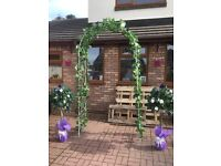 Wedding Arch and rose bushes