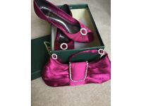 Size 6. Classy but pretty party heels with a darling bag to match!