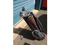 Set of 9 National Golf golf clubs, full set of irons including 3,4,5,6,7,8,9,P,S and Taylor Made bag