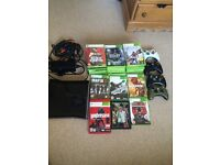 Xbox 360 slim 250gb + 31 games +four controllers