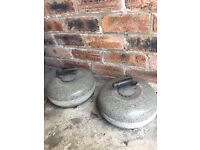 Two curling stones for sale for £100.