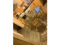 Kitchen or Dinning Table. Silver frame and glass top with 4 chairs. Collection only.