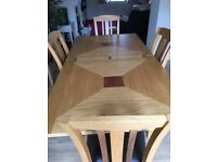 Extendable Dining room table and 4 chairs