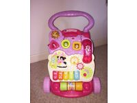 Baby girls pink first walker. Fab condition. Hardly used