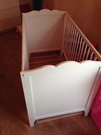 Ikea white cot excellent condition,removable chick pictures, white. Collection or local delivery