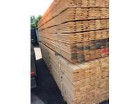 New timber log cladding 16 ft long
