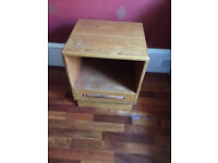Wooden bedside unit with drawer