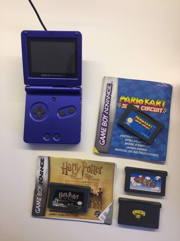 Gameboy Advance SP with 4 games and charger