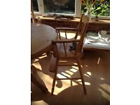 Beautiful 'BoPeep' pine high chair with removable plastic tray. Converts to high chair to table top.