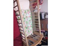Oak coloured baby swing cot